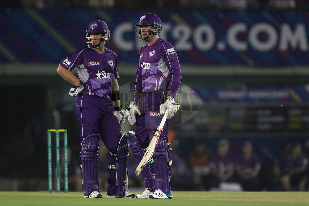 Tim PAINE (Captain) of the Hobart Hurricanes  and Ben DUNK of the Hobart Hurricanes  during match 2 of the Oppo Champions League Twenty20 between the Kings XI Punjab and the Hobart Hurricanes held at the Punjab Cricket Association Stadium, Mohali, India on the 18th September 2014<br /> <br /> Photo by:  Ron Gaunt / Sportzpics/ CLT20<br /> <br /> <br /> Image use is subject to the terms and conditions as laid out by the BCCI/ CLT20.  The terms and conditions can be downloaded here:<br /> <br /> http://sportzpics.photoshelter.com/gallery/CLT20-Image-Terms-and-Conditions-2014/G0000IfNJn535VPU/C0000QhhKadWcjYs