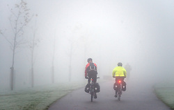 © under license to London News pictures.  16/11/2010. Cyclists battle through fog on their way to work in Ealing, West London this morning (Tues). Much of the country has been shrouded in a lingering fog conditions which are expected to last throughout the day in many places. Photo credit should read Stephen Simpson/LNP
