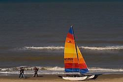 Walking along the beach in De Haan, Belgium, Sunday, Sept. 14, 2008. (Photo © Jock Fistick)