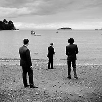 Groomsmen skipping stones on Bowen Island - Vancouver Wedding Photography