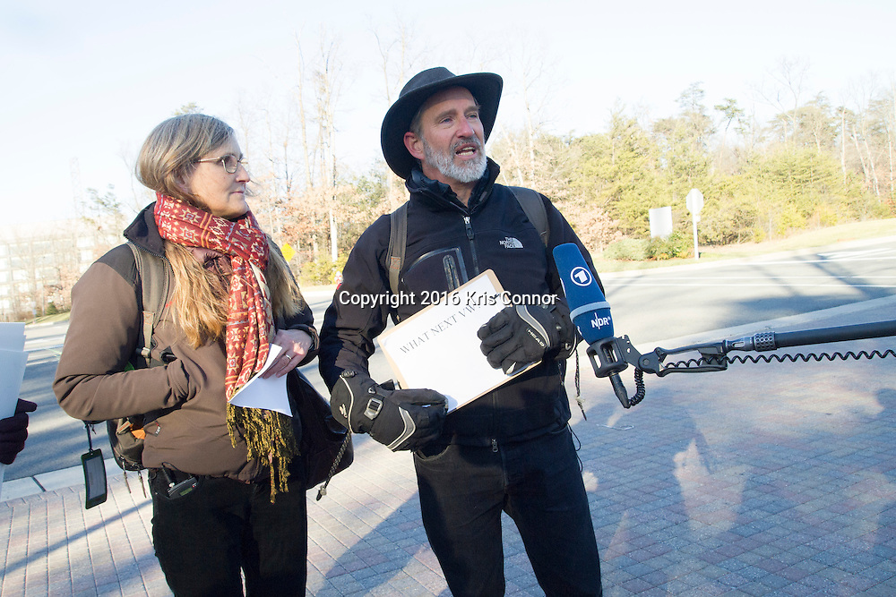 "Mike Litt , Consumer Program Advocate, U.S. PIRG, speaks with  Elisabeth Caspari and Marcus Moench during a press conference outside of the Volkswagen headquarters after trying to return their 2010 Volkswagen in Herndon, Va on Jan 19, 2016. Marcus and Elisabeth own one of the 567,000 diesel vehicles in the U.S. that Volkswagen sold as ""clean"" but was secretly designed with a ""defeat device"" to emit as much as 40 times the legal limit for smog-forming pollutants.  Photo by Kris Connor"