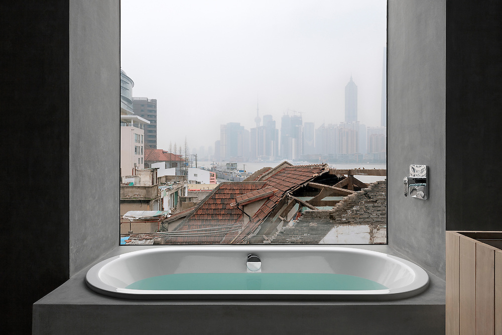 A view towards Pudong area from a bathroom of Waterhouse boutique hotel in Shanghai, China designed by NHDRO.