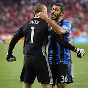 HARRISON, NEW JERSEY- November 06:  Evan Bush #1 of Montreal Impact is congratulated by teammate Victor Cabrera #36 of Montreal Impact after saving a penalty during the New York Red Bulls Vs Montreal Impact MLS playoff match at Red Bull Arena, Harrison, New Jersey on November 06, 2016 in Harrison, New Jersey. (Photo by Tim Clayton/Corbis via Getty Images)