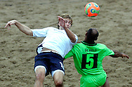09 December 2006, Englands James Temple heads past South Africas Ronald de Melo during their game at the Vodacom Pro Beach Soccer Tour in Durban's Bay of Plenty on Saturday. England won the game 3-1. Picture: Shayne Robinson, PhotoWire Africa