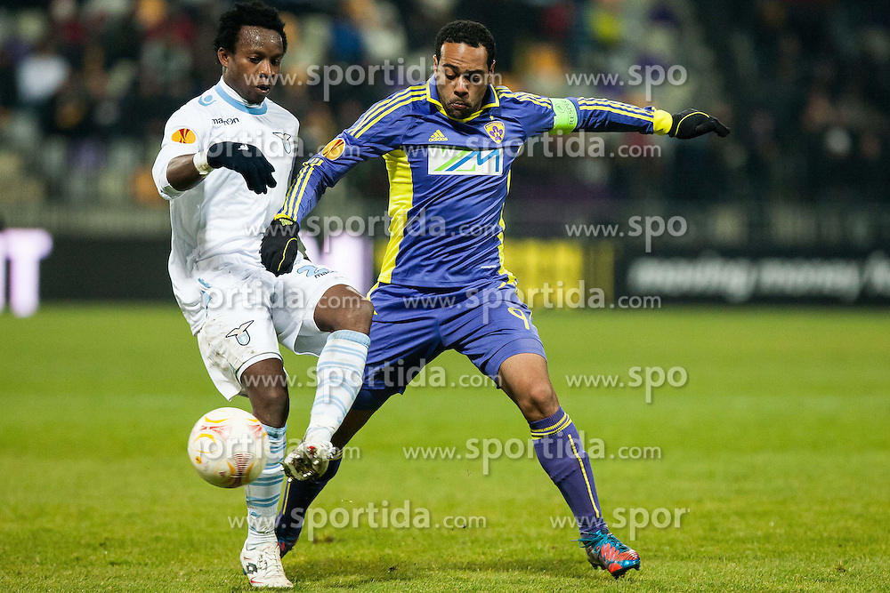 Ogenyi Onazi #23 of S.S. Lazio and Marcos Tevares #9 of Maribor during football match between NK Maribor and S. S. Lazio Roma  (ITA) in 6th Round of Group Stage of UEFA Europa league 2013, on December 6, 2012 in Stadium Ljudski vrt, Maribor, Slovenia. (Photo By Gregor Krajncic / Sportida)