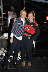 Left to right, ASTRID HARBORD and KATIE READMAN at a Girl Karting - a charity Go-Karting evening in aid of Too Many Women held at The Raceway, 3 Herringham Road, London SE7 on 12th September 2012.
