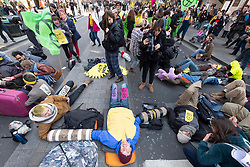 © Licensed to London News Pictures. 15/04/2019. London, UK. Extinction Rebellion environmental protesters stage a sit down protest in Oxford Circus stopping traffic as they attempt bring central London to a standstill by mounting 24-hour protests. Photo credit: Ray Tang/LNP