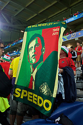 "LILLE, FRANCE - Friday, July 1, 2016: Wales supporters holds a banner ""we will never let you down Speedo"" as they celebrate the 3-1 victory against Belgium at full time after the UEFA Euro 2016 Championship Quarter-Final match at the Stade Pierre Mauroy. (Pic by Paul Greenwood/Propaganda)"