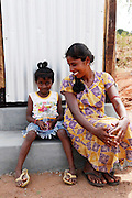 Twenty-five-year-old Thayaparan and her six-year-old daughter Mutalakshmi smile as they sit on the step of their new toilet in the village of Kalvallam, northern Sri Lanka. The toilet has been built by the UN's Office for Project Services (UNOPS), with funding from UK aid.<br /> <br /> &quot;The new toilet is amazing. We didn't have anything like this before. Now it means that my daughter won't get sick. Even though we have very little, now we have returned to a new life&quot;, says Thayaparan.<br /> <br /> &quot;Our life has been very hard, but now we feel reborn&quot;.<br /> <br /> To find out more about how UK aid from the Department for International Development is helping in Sri Lanka, please visit www.dfid.gov.uk/srilanka ( http://www.dfid.gov.uk/srilanka ) <br /> <br /> Image: Russell Watkins / Department for International Development
