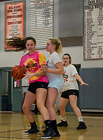 Morgan Hall gets pressure from Katie Galambos during their practice drills at Belmont High School Tuesday afternoon.  (Karen Bobotas/for the Laconia Daily Sun)