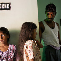 Vijyashree (left) and Vijithaa at home with their father Viswanathan.<br />