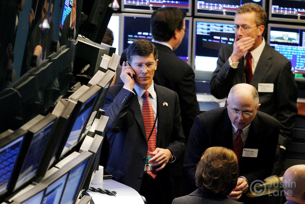 John Thain (C), the CEO of the New York Stock Exchange, is seen on the floor of the NYSE at the start of trading in New York, New York on Wednesday 28 February 2007. The Dow Jones Industrial average ended down 416 points yesterday, but stocks showed some signs of rebounding on Wednesday.