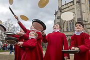 UNITED KINGDOM, Winchester: 05 March 2019 Winchester Pancake Race Photo Feature:<br /> Members belonging to the Winchester Cathedral Choir practice flipping pancakes before competing in the Inaugural Winchester Pancake Race earlier this afternoon on Shrove Tuesday. The race, which consisted of 20 teams, took place in the gardens surrounding Winchester Cathedral. <br /> Rick Findler / Story Picture Agency