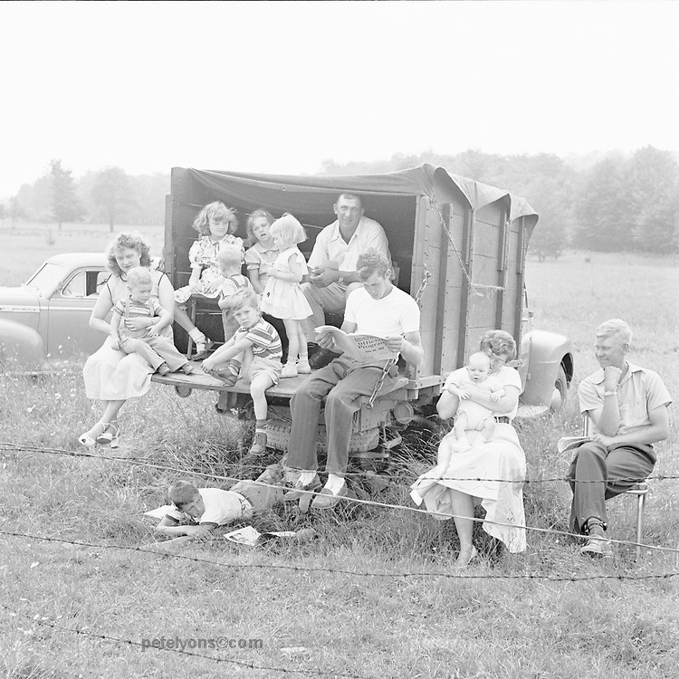 Family enjoying sports car race at Callicoon, NY, 1953.