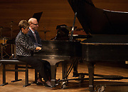 Gail Berenson, Professor Emeritus of Piano Performance, and Christopher Fisher, Professor of Piano, play Hungarian Dance No. 5 in F-sharp in Glidden Hall during the Faculty and Alumni Centennial Chamber Music Recital on Friday, April 21, 2017. © Ohio University / Photo by Kaitlin Owens
