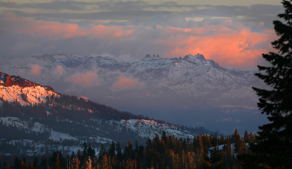 The golden glow of the sunset colors the sierra mountains. This is the view from Bear Valley Mountain Resort. January 31, 2007.