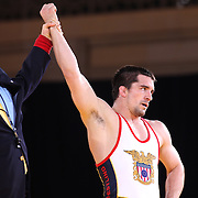 Brent Metcalf, USA, (blue) celebrates winning against Soslan Ramonov, Russia, (red) as wrestlers from USA, Iran and Russia compete at Grand Central Terminal as part of the Beat the Streets Gala. Billed ?The Rumble On The Rails,? the international wrestling event showcased competition as part of World Wrestling Month. Vanderbilt Hall, Grand Central Station, Manhattan,New York. USA. 15th May 2013. Photo Tim Clayton
