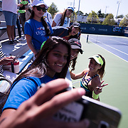 August 30, 2017 - New York, NY : Nicole Gibbs , center right, poses for photos with fans after defeating Veronica Cepede Royg (not visible) on the third day of the U.S. Open, at the USTA Billie Jean King National Tennis Center in Queens, New York, on Wednesday. <br /> CREDIT : Karsten Moran for The New York Times