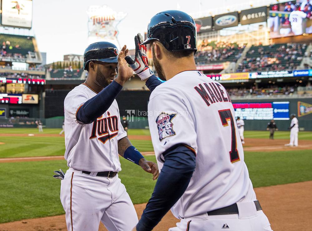 MINNEAPOLIS, MN- APRIL 30: Danny Santana #39 of the Minnesota Twins celebrates with Joe Mauer #7 against the Chicago White Sox on April 30, 2015 at Target Field in Minneapolis, Minnesota. The Twins defeated the White Sox 12-2. (Photo by Brace Hemmelgarn) *** Local Caption *** Danny Santana;Joe Mauer