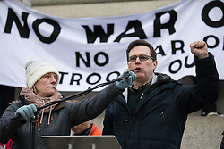 London, UK. 11 January, 2020. Austin Harney, representative of the Public and Commercial Services Union (PCS), addresses the No War on Iran demonstration in Trafalgar Square organised by Stop the War Coalition and the Campaign for Nuclear Disarmament to call for deescalation in the Middle East following the assassination by the United States of Iranian General Qassem Soleimani and the subsequent Iranian missile attack on US bases in Iraq.
