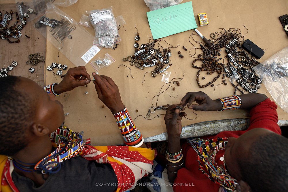 "Maasai women make key rings for the Italian fashion brand MAX&Co. at the Marula Studios, Nairob, Kenya, on Monday, Jan. 12, 2009. The Maasai tribe are renowned for their expert bead work and as such have been hired to help create part of MAX&Co.'s ""ethical fashion"" range in Africa. The limited edition collection consists of a range of handmade accessories such as shoulder-bags, bracelets, key-rings, belts and scarfs."