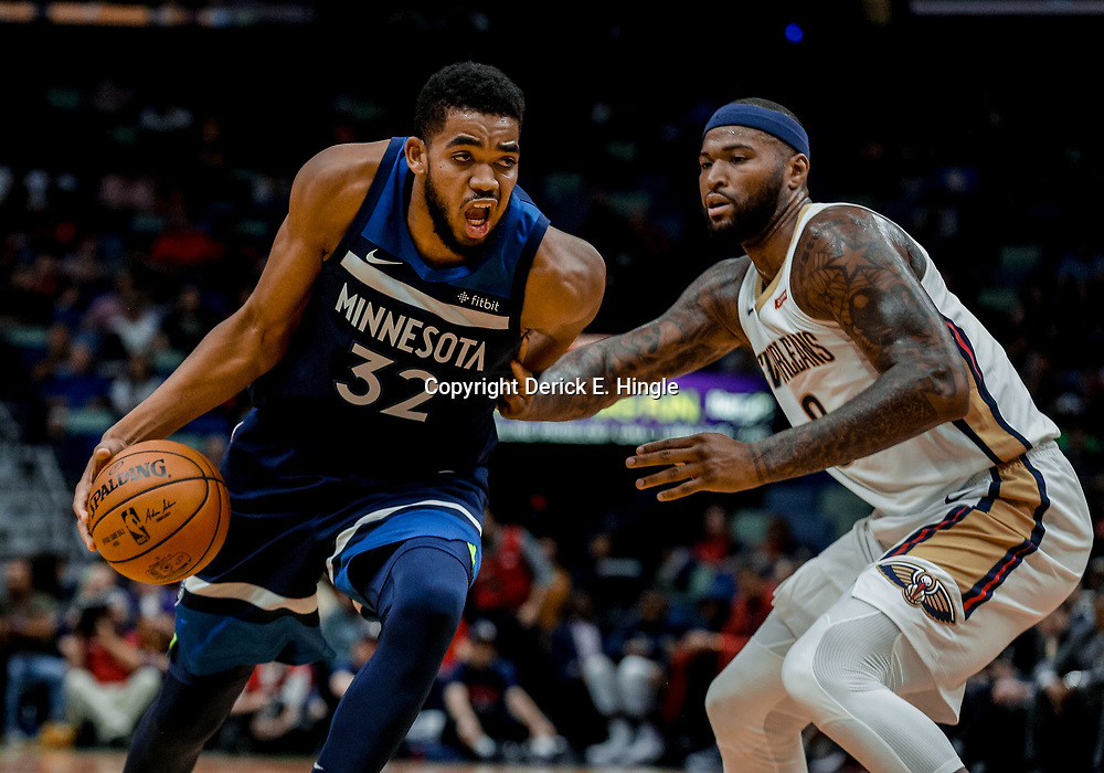 Nov 1, 2017; New Orleans, LA, USA; Minnesota Timberwolves center Karl-Anthony Towns (32) drives past New Orleans Pelicans center DeMarcus Cousins (0) during the first quarter of a game at the Smoothie King Center. Mandatory Credit: Derick E. Hingle-USA TODAY Sports