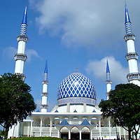Iconic Blue Mosque in Shah Alam, Malaysia<br /> About a 45 minute drive from Kuala Lumpur is one of Malaysia&rsquo;s most iconic sites: the Blue Mosque. It is located in Shah Alam, the capital city of the state of Selangor. This Islamic structure features four slender minarets. They each reach a height of 460 feet, making them the world&rsquo;s tallest when construction ended in 1988. The Sultan Salahuddin Abdul Aziz Shah Mosque is also Southeast Asia&rsquo;s second largest mosque.