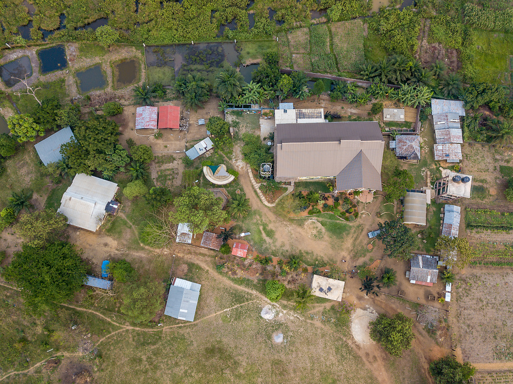 Aerial shot of houses and a farm in Ganta Liberia
