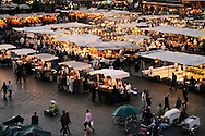 Morocco, Marrakesh. Restaurants in Djemaa el Fna Square in the evening.