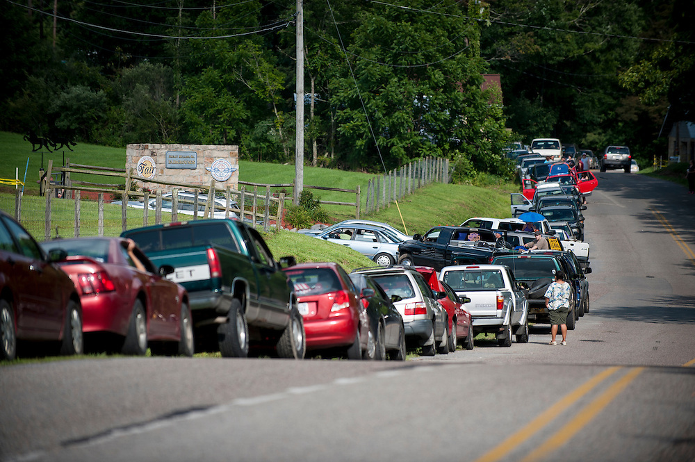 People wait for the gates to open at the Wise County Fairgrounds where they hope to receive free medical care at the 16th annual Remote Area Medical (RAM), clinic in Wise, Virginia, U.S., on Thursday, July 16, 2015. RAM is a nonprofit that delivers free medical care to people living in rural areas. On RAM's first day it took in over 1,600 patients, setting an opening day record. By noon on Saturday, RAM had taken in another 1,000 patients. One woman's life may have been saved on Friday after women's health physicians determined she had a dangerous ectopic (tubal) pregnancy. She was taken to an area hospital for further care. In recent years, 2,500 to 3,000 people have sought care at this clinic at the fairgrounds. Photographer: Pete Marovich/Bloomberg
