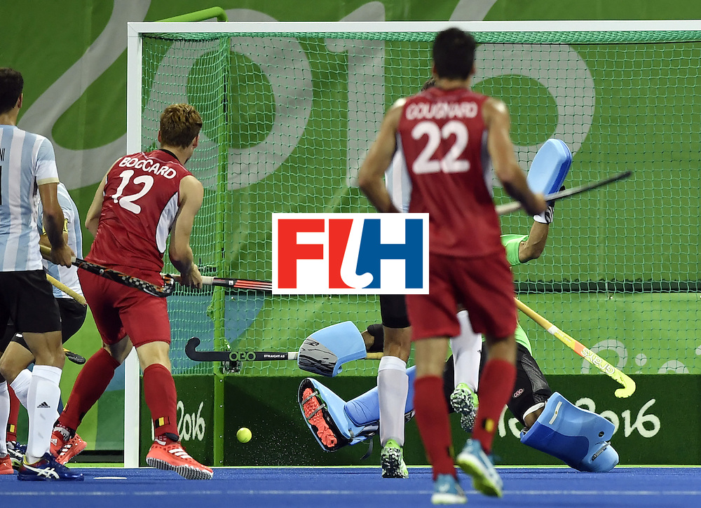 Belgium's Gauthier Boccard (L) scores a goal during the men's Gold medal field hockey Belgium vs Argentina match of the Rio 2016 Olympics Games at the Olympic Hockey Centre in Rio de Janeiro on August 18, 2016. / AFP / PHILIPPE LOPEZ        (Photo credit should read PHILIPPE LOPEZ/AFP/Getty Images)
