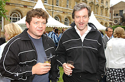 Left to right, LORD ADDINGTON and the EARL OF DUNDEE at the annual House of Lords v House of Commons tug of war match in aid of  of  Macmillan Cancer Relief on 22nd June 2004.  A drinks reception was held in College Gardens followd by the tug of war on Victoria Tower Gardens, London.