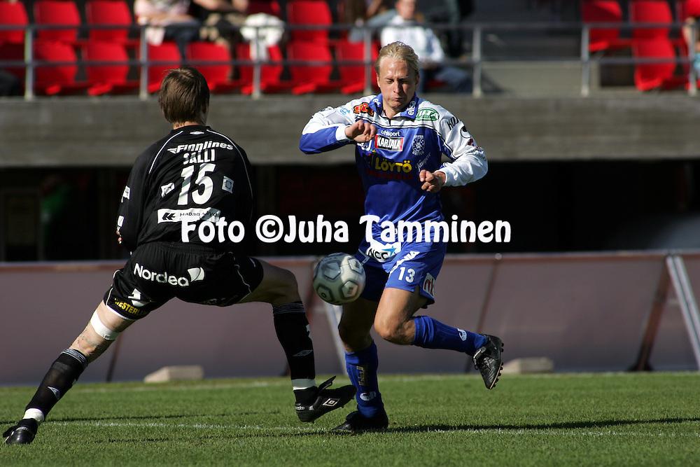 21.05.2005, Ratina, Tampere, Finland..Veikkausliiga 2005 / Finnish League 2005.Tampere United v FC Haka.Sakari Saarinen (TamU) v Janne Salli (Haka).©Juha Tamminen.....ARK:k