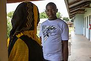 Dr Godfrey Kambanga chatting to a patients mother in passing on one of the hospital corridors. St Walburg's Hospital, Nyangao. Lindi Region, Tanzania.