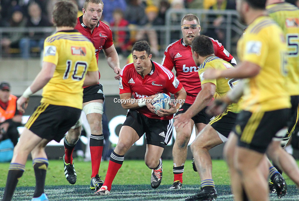 Crusaders' Dan Carter looks to make a break during the Round 17 Super Rugby match, between the Hurricanes & Crusaders. Westpac Stadium, Wellington. 28 June 2014. Photo.: Grant Down / www.photosport.co.nz
