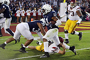 Penn State Nittany Lions linebacker Brandon Bell (11) gets tackled at the USC Trojans 3 yard line after Bell intercepts a third quarter pass during the 2017 NCAA Rose Bowl college football game against the USC Trojans, Monday, Jan. 2, 2017 in Pasadena, Calif. The Trojans won the game 52-49. (©Paul Anthony Spinelli)