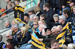 A Wasps fan in the crowd waves a flag in support - Mandatory byline: Patrick Khachfe/JMP - 07966 386802 - 12/10/2019 - RUGBY UNION - Ricoh Arena - Coventry, England - Wasps v Worcester Warriors - Premiership Rugby Cup