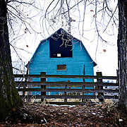 Blue barn between two trees in Providence, Utah Dec. 6, 2010.
