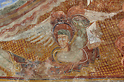 Detail of Mark the Evangelist, flanked by a lion, his symbolic attribute in the desert, 12th century frescoes in the choir of the Pre-Romanesque Chapel of Saint Martin de Fenollar (Sant Marti de Fenollar), 9th century, Maureillas Les Illas, Pyrenees Orientales, France. The frescoes are an outstanding piece of work, which greatly impressed modern artists, especially Pablo Picasso and Georges Braque in 1910. Picture by Manuel Cohen