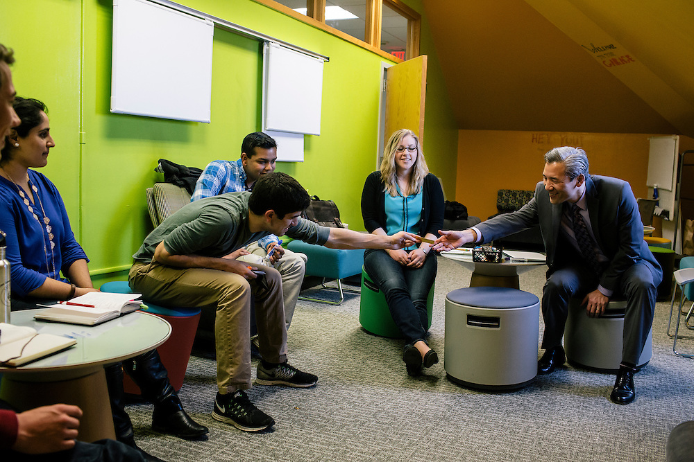 Members of Dean Chang's internal team  discuss topics in a room called the Garage inside Symons Hall, during their weekly meeting at the University of Maryland on April 1, 2015. Chang is the Associate Vice President for Innovation and Entrepreneurship at the University, a growing program that Chang integrates into the already established disciplines at UMD.