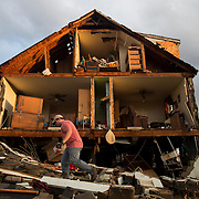Nick Mobley helps clean up a house owned by a family friend at 13720 Richmond Highway on Wednesday February 24, 2016 after a storm in Appomattox County, Va. hit the area with high winds a possible tornado.  Photo by Jill Nance