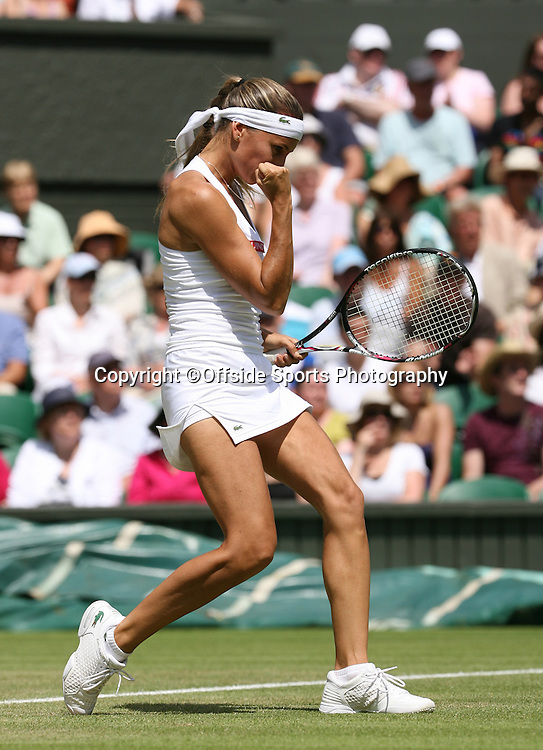 24/06/2009. The All England Lawn Tennis Championships. Gisela Dulko celebrates a point during her 2nd round match with Maria Sharapova. Wimbledon, UK. Photo: Offside/Steve Bardens.