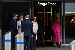 The Duke of Edinburgh makes a joke (left) as the Queen (right) enters through the stage door.<br /> The Queen and the Duke of Edinburgh visit the National Theatre for a guided tour on the anniversary of it opening 50 years ago at the National Theatre, London, United Kingdom. Tuesday, 22nd October 2013. Picture by Ben Stevens / i-Images