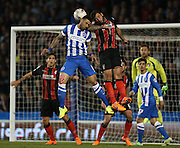 Leon Best, Brighton striker and AFC Bournemouth defender Steve Cook during the Sky Bet Championship match between Brighton and Hove Albion and Bournemouth at the American Express Community Stadium, Brighton and Hove, England on 10 April 2015.