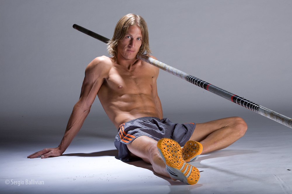 Studio portrait of a mid-adult male pole-vaulter in Denver, CO