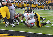 November 20 2010: Ohio State Buckeyes running back Dan Herron (1) reaches for the goal line as he is hit by Iowa Hawkeyes defensive end Adrian Clayborn (94) during the second quarter of the NCAA football game between the Ohio State Buckeyes and the Iowa Hawkeyes at Kinnick Stadium in Iowa City, Iowa on Saturday November 20, 2010. Ohio State defeated Iowa 20-17.