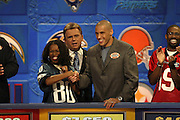 Philadelphia Eagles wide receiver James Thrash appears with show host Pat Sajak and a contestant at NFL Players Week on Wheel of Fortune on 11/04/2003. ©Paul Anthony Spinelli