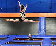 LEVITTOWN, PA - AUGUST 19: jamie Allen, 16 of Levittown, Pennsylvania does some gymnastic moves while on a trampoline at the grand opening of Sky Zone Indoor Trampoline Park August 19, 2014 in Levittown, Pennsylvania. A portion of the grand opening day proceeds to Alex's Lemonade Stand Foundation. (Photo by William Thomas Cain/Cain Images)