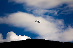 A Black Hawk helicopter traverses the sky. One of the cowboys I was with surmised that the helicopter belongs to one of the Koch brothers, who owns property a few valleys over.