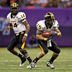 Dec 20, 2009; New Orleans, LA, USA; Southern Miss Golden Eagles running back Damion Fletcher (25) takes a handoff from quarterback Martevious Young (14) during the 2009 New Orleans Bowl at the Louisiana Superdome. Middle Tennessee State defeated Southern Miss 42-32. Mandatory Credit: Derick E. Hingle-US PRESSWIRE
